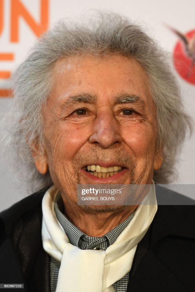 French accordionist and composer Francis Lai poses during the photocall for the premiere of the film 'Chacun Sa Vie' in Paris on March 13, 2017. The film is directed by French director Claude Lelouch. /