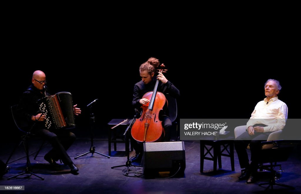 French accordionist Daniel Mille (L), French cellist Gregoire Korniluk (C) and French actor Jean-Louis Trintignant (R) perform onstage during a poetic recital on October 1, 2013, at the Anthea theater in Antibes, southeastern France. Trintigant and 82-year-old Oscar-winning actor is bowing out of a critically-acclaimed career after announcing in an interview published on September 23, 2013 in the French newspaper Nice-Matin that this would be his last performance.