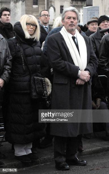 French Actor Alain Delon and French Actress Mireille Darc attend publicist Georges Cravenne's Funeral at Montparnasse Cemetery on January 14 2009 in...