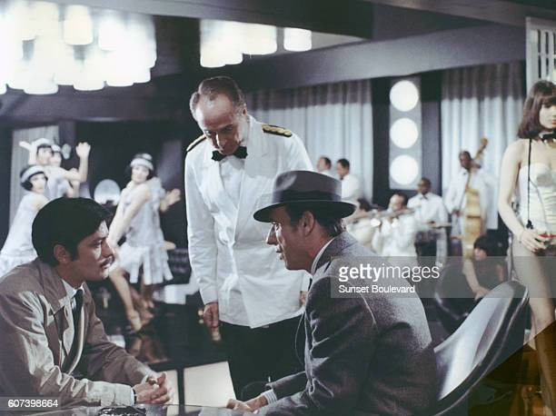 French actor Alain Delon and Italianborn French actor and singer Yves Montand on the set of Le Cercle Rouge written and directed by JeanPierre...
