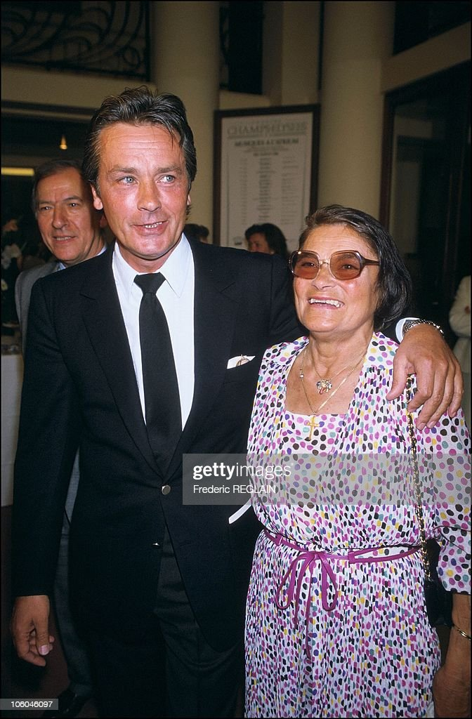 French actor <a gi-track='captionPersonalityLinkClicked' href=/galleries/search?phrase=Alain+Delon&family=editorial&specificpeople=228460 ng-click='$event.stopPropagation()'>Alain Delon</a> is pictured with his mother as he receives the medal of Order of Arts and Letters from Jack Lang, French Culture Minister, on May 26, 1986 in Paris, France.