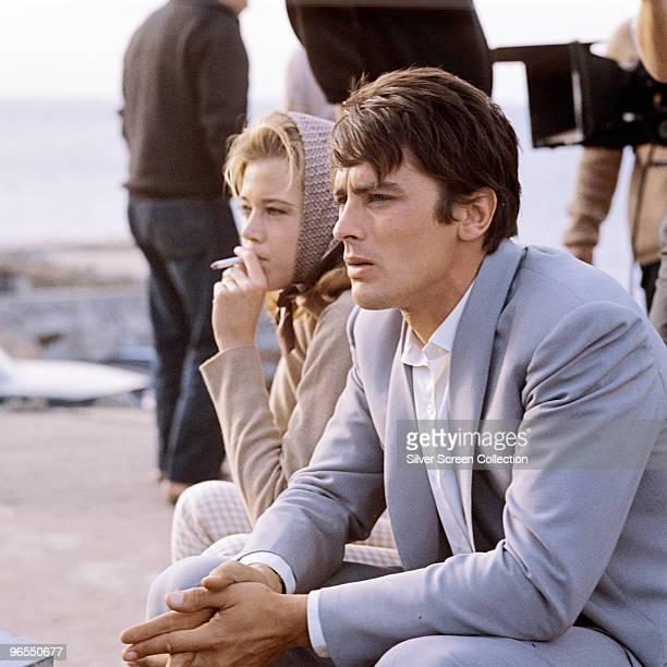 French actor Alain Delon relaxes on a film set circa 1965