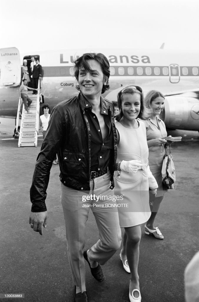 French actor <a gi-track='captionPersonalityLinkClicked' href=/galleries/search?phrase=Alain+Delon&family=editorial&specificpeople=228460 ng-click='$event.stopPropagation()'>Alain Delon</a> welcomes Austrian born actress <a gi-track='captionPersonalityLinkClicked' href=/galleries/search?phrase=Romy+Schneider&family=editorial&specificpeople=672667 ng-click='$event.stopPropagation()'>Romy Schneider</a> at Nice airport before travelling to the set of the the movie 'The Swimming Pool' (La Piscine), directed by Jacques Deray, August 1968 in Nice, France.