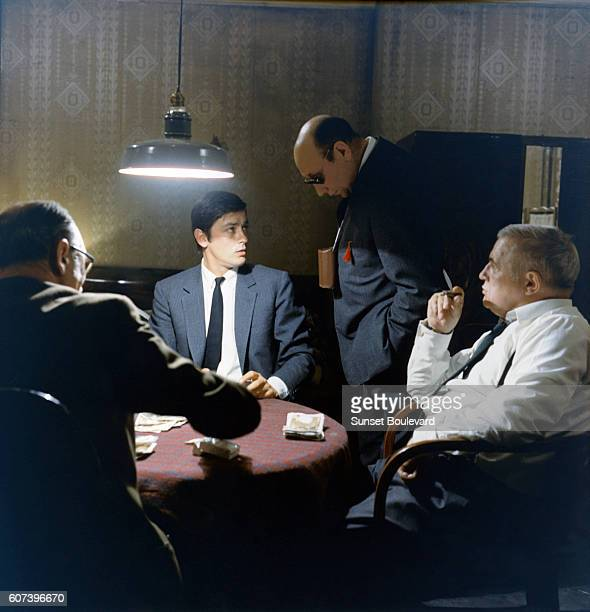 French actor Alain Delon with director and screenwriter JeanPierre Melville on the set of his movie Le Samourai