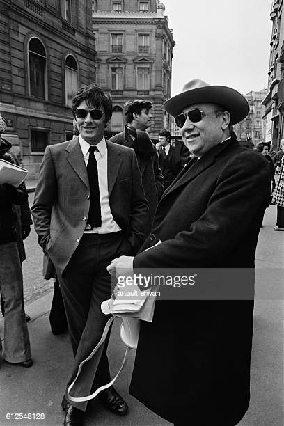 French actor Alain Delon with director and screenwriter JeanPierre Melville on the set of his movie Un Flic