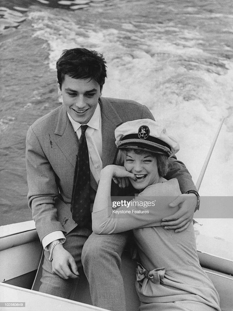 French actor Alain Delon with his fiancee, German actress Romy Schneider (1938 - 1982) take a boat trip on Lake Lugano, Italy, 25th March 1959. The couple have just announced their engagement and are staying at a villa owned by Schneider's father.