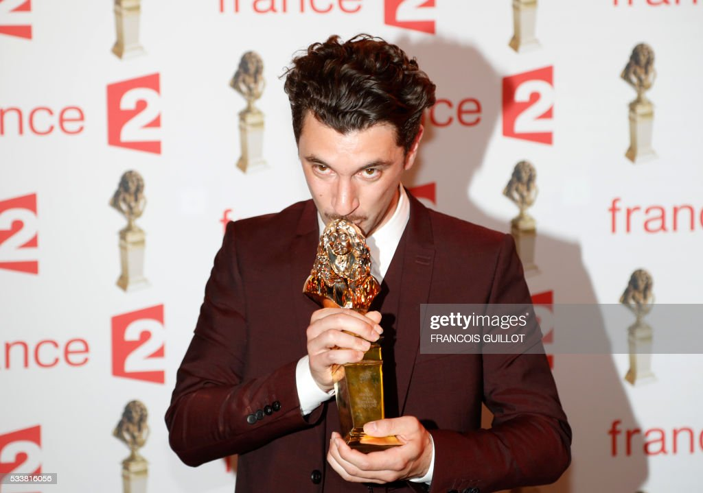 French actor Alexis Moncorge poses after receiving the Moliere Award for best male revelation for the play 'Amok' during the 28th Ceremony of the French Theatre Molieres awards at the Folies Bergeres in Paris, on May 23, 2016. / AFP / FRANCOIS