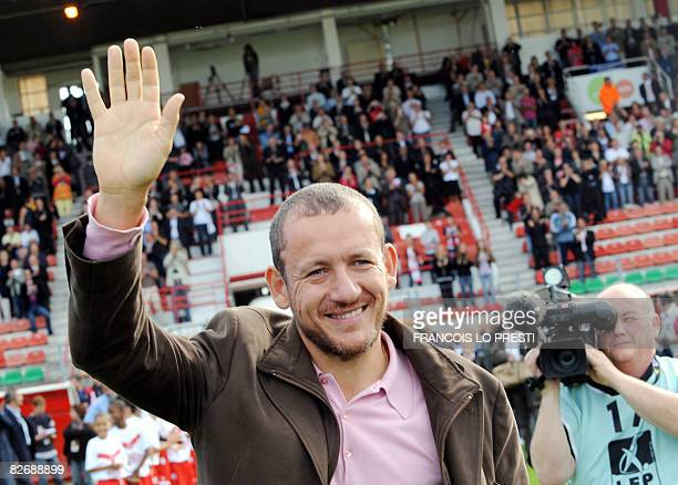 French actor and comedian Dany Boon waves to the crowd on September 6 2008 at the Nungesser stadium in Valenciennes northern France prior to a...