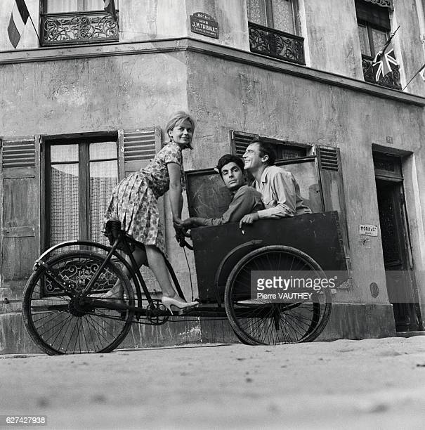 French actor and comedian JeanMarc Thibault rides in a bicycle cart with a fellow actor They are rehearsing for the Gala de l'Union des Artistes