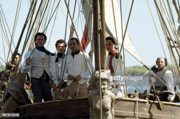 French actor and director Bernard Giraudeau and actors Thierry Fremont Richard Bohringer Vincent de Bouard and Roland Blanche on the set of...