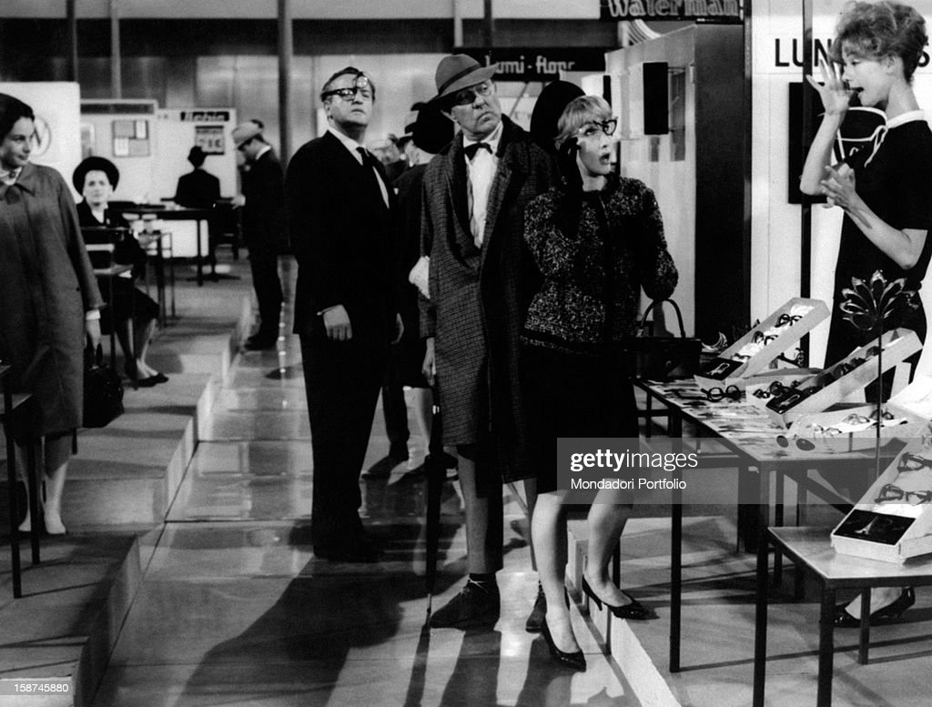 French actor and director Jacques Tati (Jacques Tatischeff), French actress France Rumilly (Marie-Francoise Rumilly) and actresses Barbara Dennek and Rita Maiden acting in Playtime. France, 1967