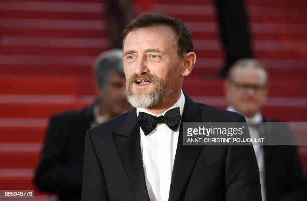 French actor and director JeanPaul Rouve poses as he arrives on May 19 2017 for the screening of the film 'Okja' at the 70th edition of the Cannes...