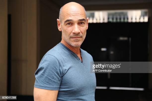 French actor and film director JeanMarc Barr poses on July 22 in Paris / AFP PHOTO / Laurence THOMANN