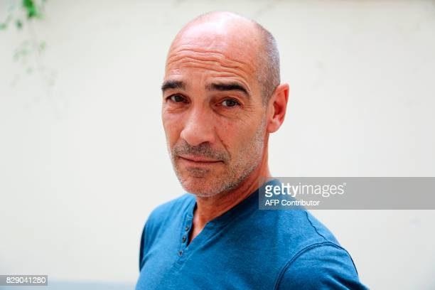 French actor and film director JeanMarc Barr poses on July 22 in Paris 'Jacques Mayol l'homme dauphin' a documentary dedicated to French apneist...