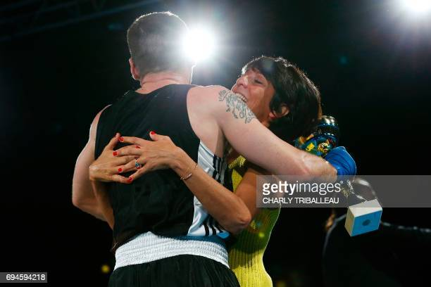 French actor and filmmaker Mathieu Kassovitz hugs French comedian Florence Foresti after his fight against Franck Barigault at the 'Boxing For...