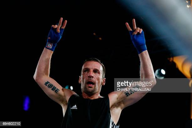 French actor and filmmaker Mathieu Kassovitz reacts after fighting against Franck Barigault during the 'Boxing For Legend' event on June 10 in...