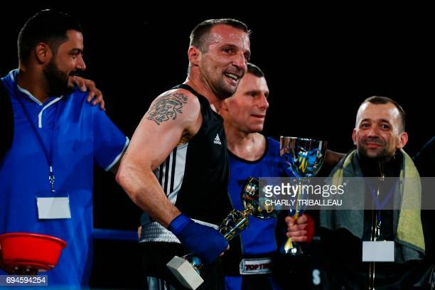 French actor and filmmaker Mathieu Kassovitz reacts after his fight against Franck Barigault at the 'Boxing For Legend' event on June 10 in Deauville...