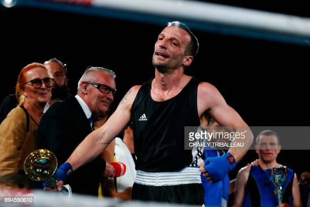 French actor and filmmaker Mathieu Kassovitz reacts as he fights against Franck Barigault during the 'Boxing For Legend' event on June 10 in...