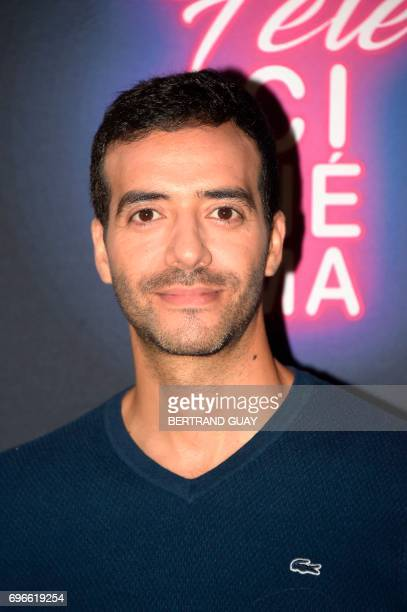 French actor and filmmaker Tarek Boudali poses during a photocall for the press launch of the 33rd edition of the Fete du Cinema at the Cite du...