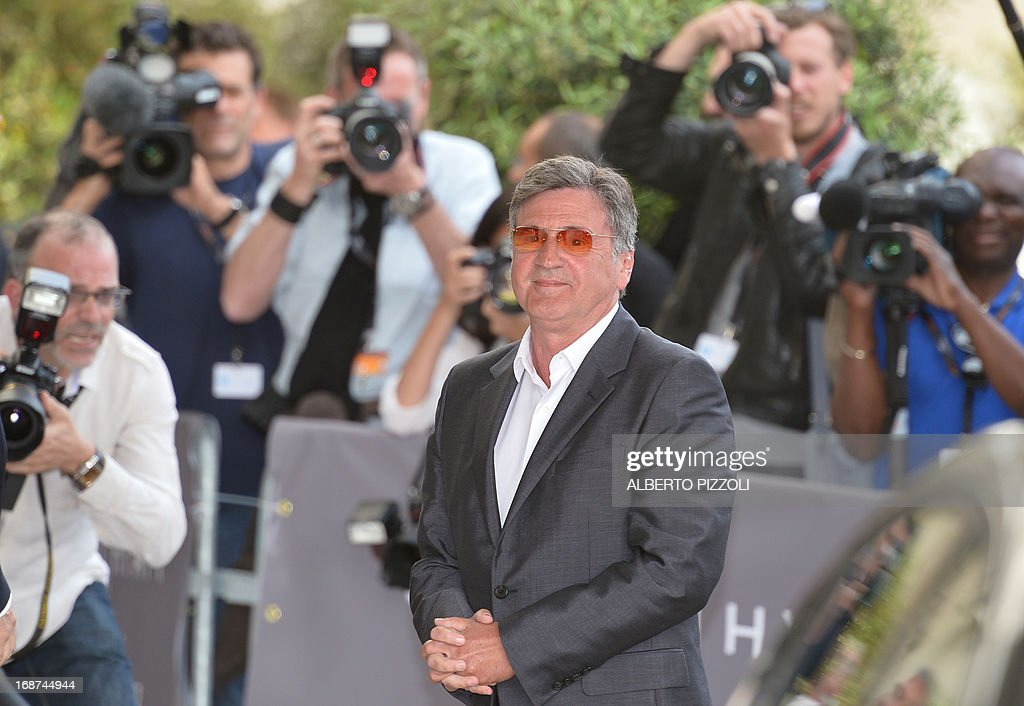 French actor and member of the Feature Film Jury, Daniel Auteuil arrives on May 14, 2013 at the Martinez Hotel in Cannes to attend a photocall of the Jury on the eve of the 66th edition of the Cannes Film Festival. Cannes, one of the world's top film festivals, opens on May 15 and will climax on May 26 with awards selected by a jury headed this year by Hollywood legend Steven Spielberg. AFP PHOTO / ALBERTO PIZZOLI