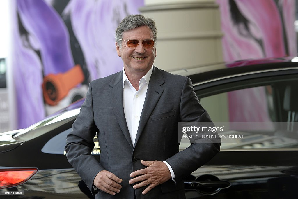 French actor and member of the Feature Film Jury, Daniel Auteuil smiles on May 14, 2013 as he arrives at the Martinez Hotel in Cannes to attend a photocall of the Jury on the eve of the 66th edition of the Cannes Film Festival. Cannes, one of the world's top film festivals, opens on May 15 and will climax on May 26 with awards selected by a jury headed this year by Hollywood legend Steven Spielberg.