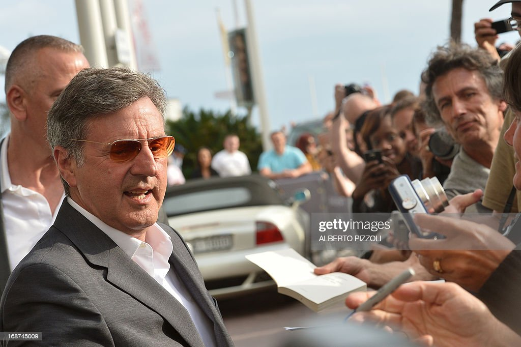 French actor and member of the Feature Film Jury Daniel Auteuil arrives on May 14, 2013 at the Martinez Hotel in Cannes to attend a photocall of the Jury on the eve of the 66th edition of the Cannes Film Festival. Cannes, one of the world's top film festivals, opens on May 15 and will climax on May 26 with awards selected by a jury headed this year by Hollywood legend Steven Spielberg.