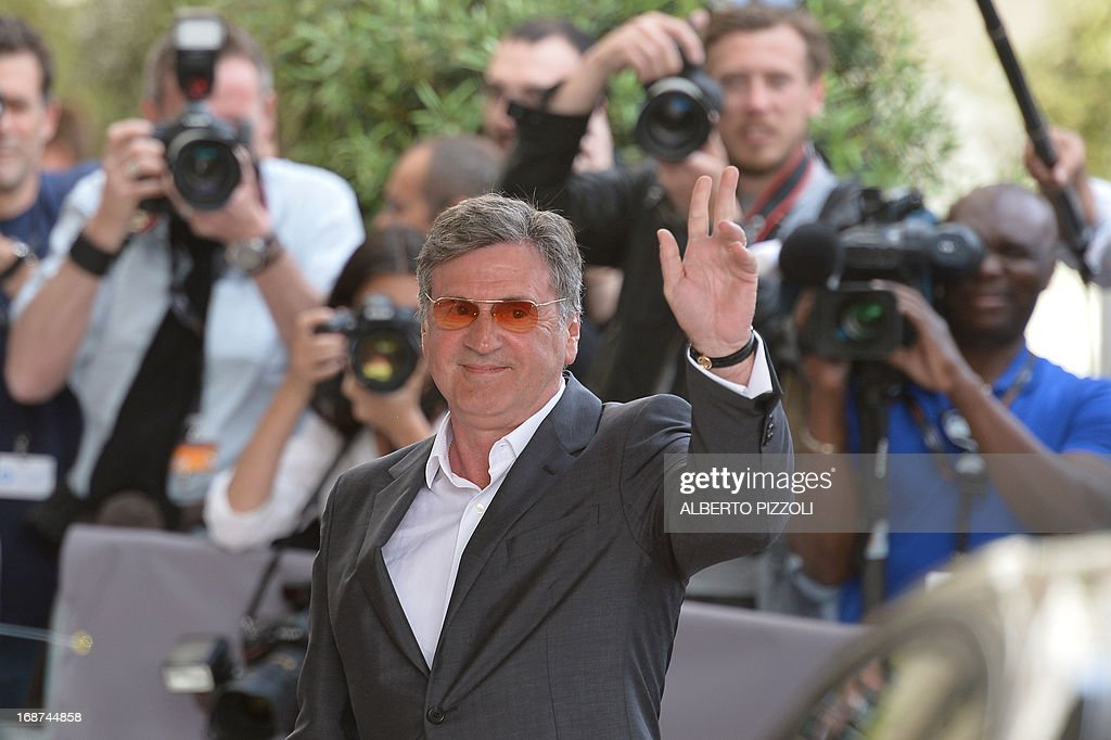 French actor and member of the Feature Film Jury Daniel Auteuil waves on May 14, 2013 as he arrives at the Martinez Hotel in Cannes to attend a photocall of the Jury on the eve of the 66th edition of the Cannes Film Festival. Cannes, one of the world's top film festivals, opens on May 15 and will climax on May 26 with awards selected by a jury headed this year by Hollywood legend Steven Spielberg.