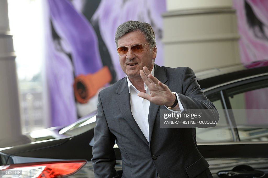 French actor and member of the Feature Film Jury, Daniel Auteuil waves on May 14, 2013 as he arrives at the Martinez Hotel in Cannes to attend a photocall of the Jury on the eve of the 66th edition of the Cannes Film Festival. Cannes, one of the world's top film festivals, opens on May 15 and will climax on May 26 with awards selected by a jury headed this year by Hollywood legend Steven Spielberg.