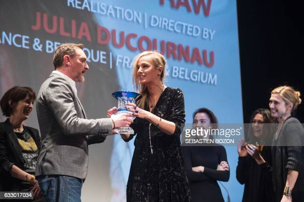 French actor and President of the jury JeanPaul Rouve gives the jury price to French filmmaker Julia Ducournau as French actresses Garance Marillier...