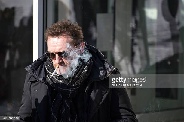 French actor and President of the jury of the 24th Geradmer fantastic film festival JeanPaul Rouve smokes during a photocall in Gerardmer on January...