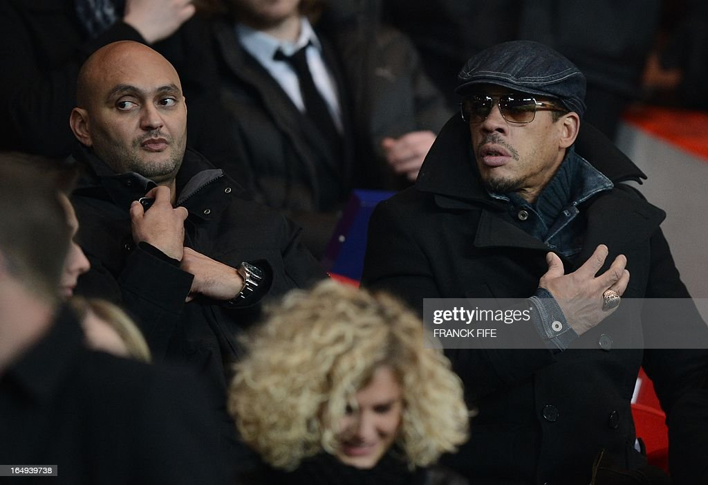 French actor and rapper Joey Starr (R) looks on during a French Ligue 1 football match between Paris Saint-Germain and Montpellier at Parc des Princes stadium in Paris on March 29, 2013.