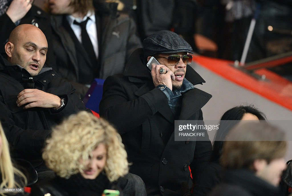 French actor and rapper Joey Starr watches a French Ligue 1 football match between Paris Saint-Germain and Montpellier at Parc des Princes stadium in Paris on March 29, 2013.