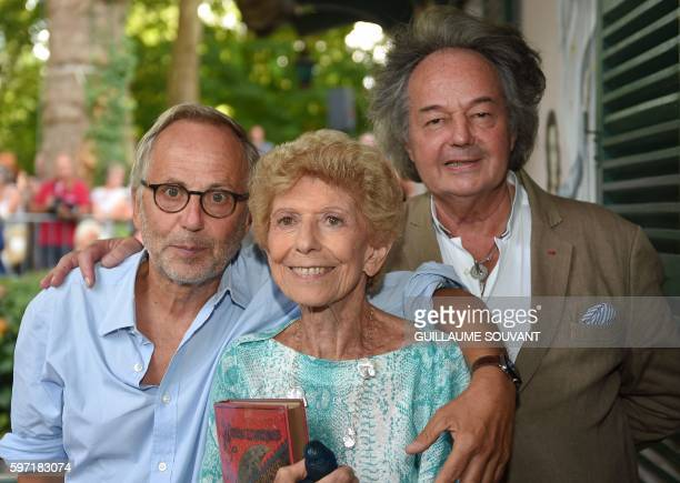 French actor and writer Fabrice Luchini French academician Helene Carrere d'Encausse and French writer Gonzague SaintBris pose during the 21th book...
