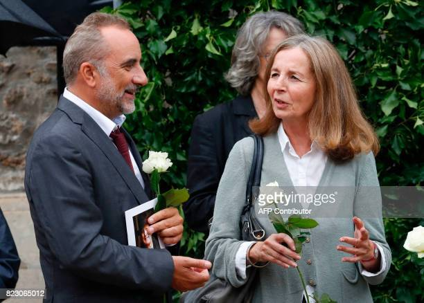 French actor Antoine Dulery speaks with French architect and French actor Jean Rochefort's wife Françoise Vidal after a funeral ceremony for late...