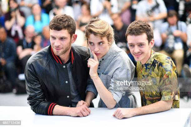 French actor Arnaud Valois French actress Adele Haenel and Argentinian actor Nahuel Perez Biscayart pose on May 20 2017 during a photocall for the...