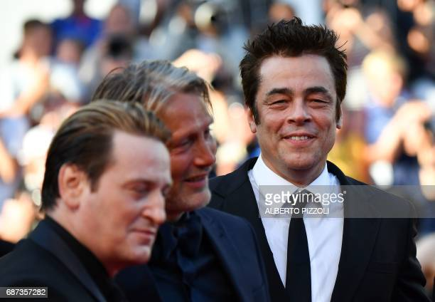 French actor Benoit Magimel Danish actor Mads Mikkelsen and Puerto Rican actor Benicio del Toro pose as they arrive on May 23 2017 for the '70th...