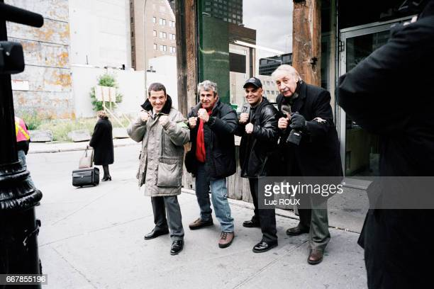 French actor Bruno Putzulu actor and director Michel Boujenah a member of the film crew and actor Philippe Noiret on the set of Boujenah's film Pere...