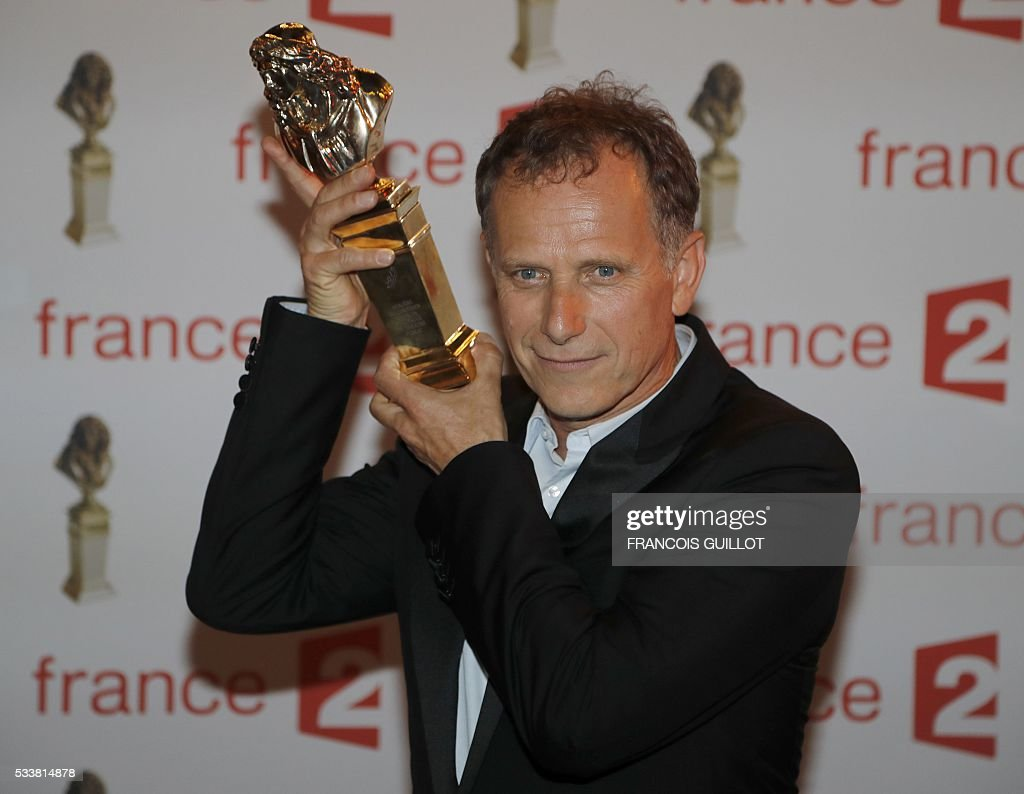 French actor Charles Berling poses after receiving the Moliere Award for Best Actor in a public theatre during the 28th Ceremony of the French Theatre Molieres awards at the Folies Bergers in Paris, on May 23, 2016. GUILLOT