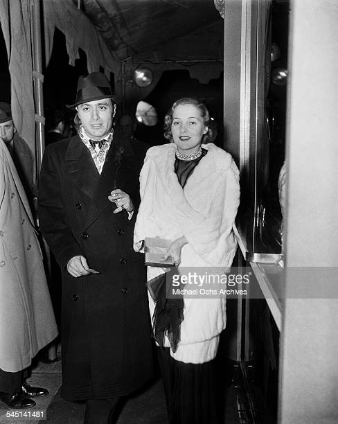 French actor Charles Boyer and wife Pat Paterson arrive at an event in Los Angeles California