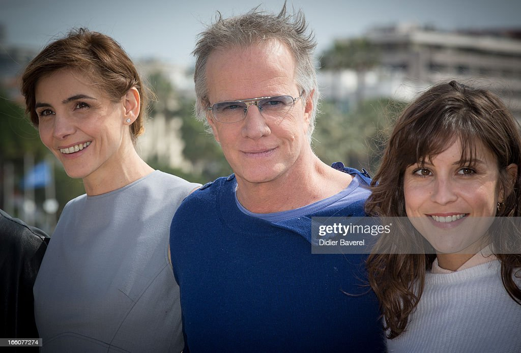 French actor Christophe Lambert, actress Clotilde Courau (L) and actress Flore Bonaventura (R) pose during a photocall for the tv series'La Source' at MIP TV 2013 on April 8, 2013 in Cannes, France.