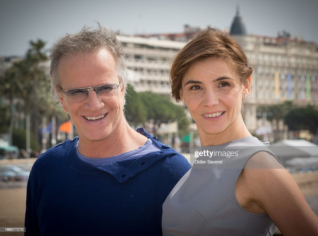 French actor Christophe Lambert and actress <a gi-track='captionPersonalityLinkClicked' href=/galleries/search?phrase=Clotilde+Courau&family=editorial&specificpeople=171279 ng-click='$event.stopPropagation()'>Clotilde Courau</a> pose during a photocall for the tv series'La Source' at MIP TV 2013 on April 8, 2013 in Cannes, France.