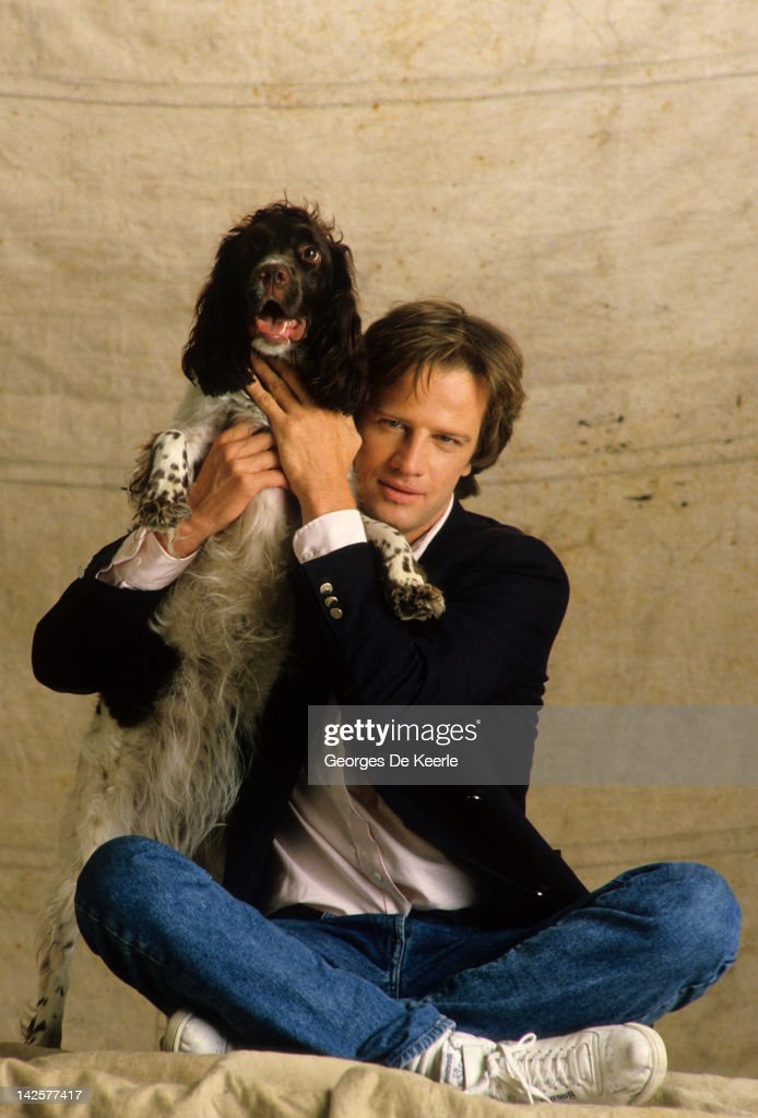 French actor Christopher Lambert and his dog pose on a portrait session Great Britain June 1985
