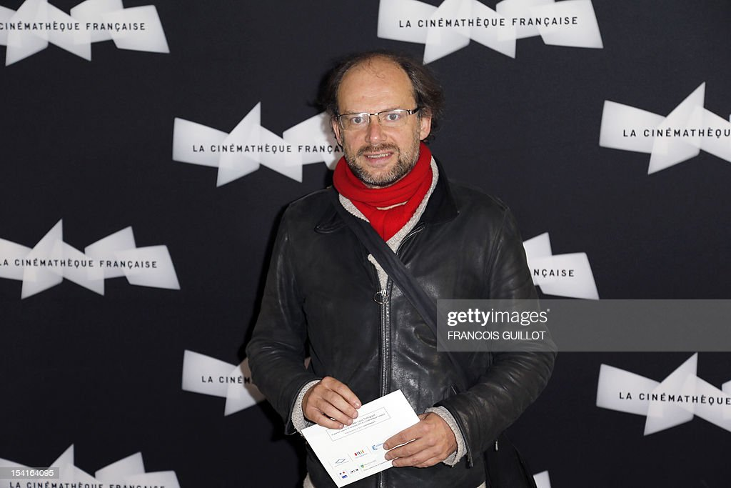 French actor Denis Podalydes poses during a photocall prior to the premiere screening of the movie 'Amour', awarded the 2012 Cannes film festival Palme d'Or, on October 15, 2012 in Paris.