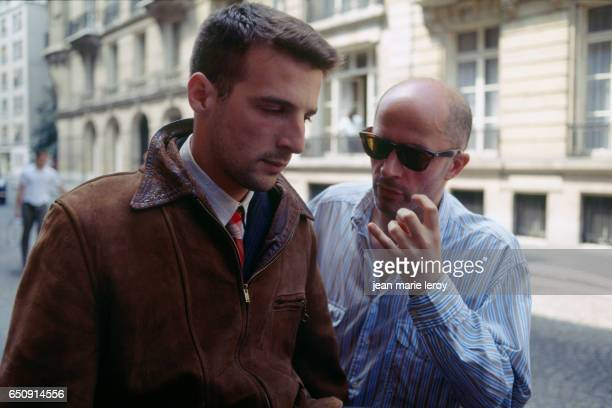 French actor director screenwriter and producer Mathieu Kassovitz and director and screenwriter Jacques Audiard on the set of Audiard's film 'Un...