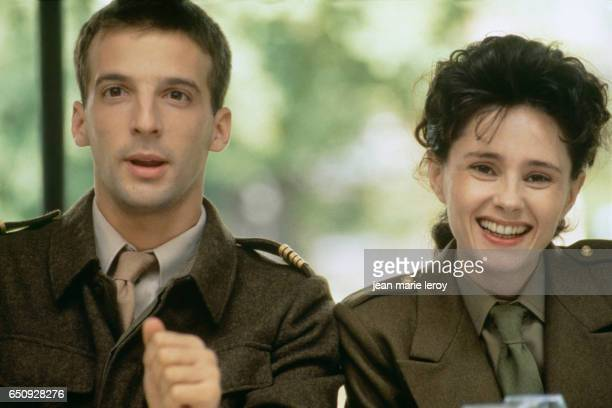 French actor director screenwriter and producer Mathieu Kassovitz and Belgian actress Anouk Grinberg on the set of 'Un Heros Tres Discret' by French...