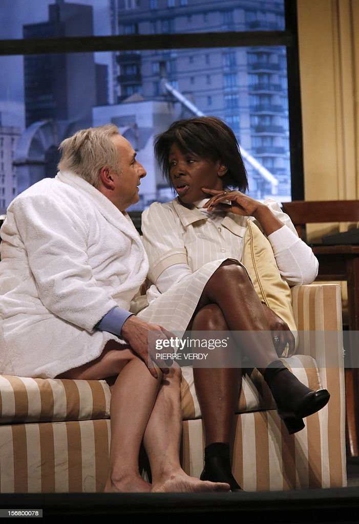 French actor Eric Debrosse (L), acting as former French International Monetary Fund (FMI) Director Dominique Strauss-Kahn, and Jelle Saminnadin playing Guinean Nafissatou Diallo (R), the New York Sofitel hotel housemaid, perform on November 21, 2012 the play of French Guillaume Landrot at the Paris Daunou Theater. Strauss-Kahn had been the favorite to win the May 2012 French presidential elections until May 2011, when he was arrested in New York and charged with sexually assaulting Diallo.