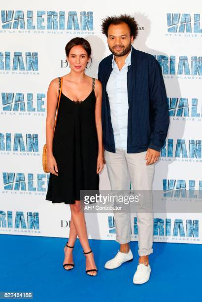 French actor Fabrice Eboue and his wife actress Amelle Chahbi pose for a photograph upon arrival for the prepremiere of the film 'Valerian and The...