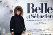 French actor Felix Bossuet poses before the presentation of the movie 'Belle and Sébastien' of French film director Nicolas Vanier on November 17...