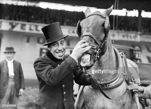 French actor Fernandel poses with a horse in 1937 // Portrait pris en 1937 de l'acteur français Fernandel de son vrai nom Fernand Contandin Né à...