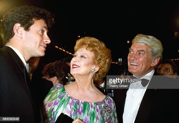 French actor Francis Huster actress Edwige Feuillere and actor Jean Marais at a party held in the honor of Marais Marais was celebrating his 50 years...